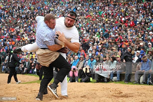 Swiss Alpine wrestler Simon Anderegg fights with Gerry Sueess during the Alpine Wrestling Festival BruenigSchwinget at the top of the Bruenig Pass on...