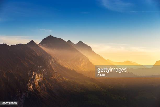 swiss alps, high mountain, in sunset time view from harder kulm viewpoint - clima alpino foto e immagini stock