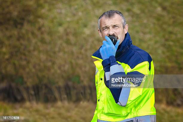 Swiss alps paramedic man using CB radio