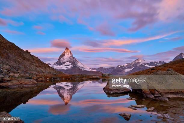 swiss alps's matterhorn at sunrise, switzerland - zermatt stock pictures, royalty-free photos & images