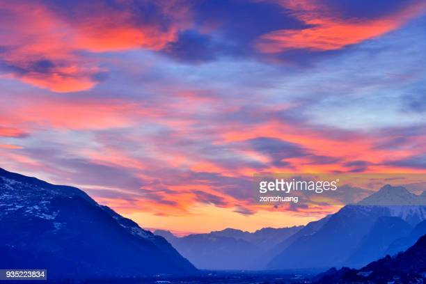 swiss alps's valley at dramatic sky, switzerland - orange sky stock pictures, royalty-free photos & images