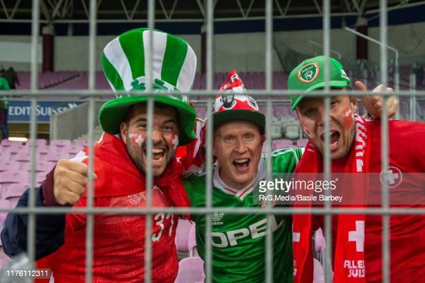Swiss and Irish fans cheer before the UEFA Euro 2020 qualifier between Switzerland and Republic of Ireland on October 15 2019 in Geneva Switzerland