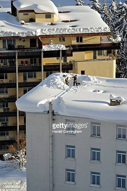 Swiss army soldiers dig snow trenches on a roof on January 10 2012 in Davos Switzerland The World Economic Forum which gathers the World's top...