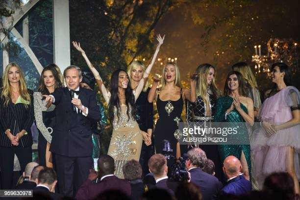 Swiss art auctioneer Simon de Pury and French designer and fashion editor Carine Roitfeld conduct an auction after 32 models presented outfits on...