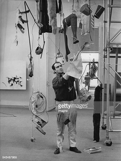 Swiss artist Jean Tinguely with huis sculpture Ballet des pauvres at the Modern Museum Stockholm Sweden 16th May 1961 Photograph