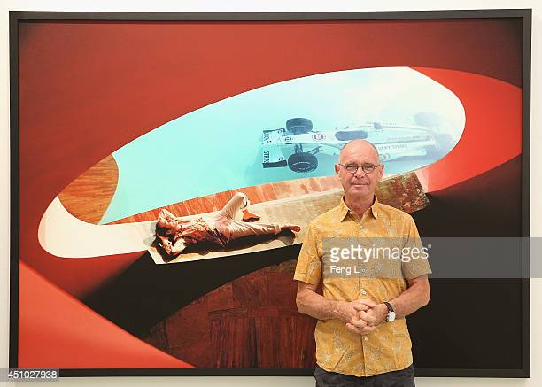 Swiss artist photographer Hannes Schmid poses for photos in front of his works during the opening of Hannes Schmid's MOMENTOUS presented by UBS at...