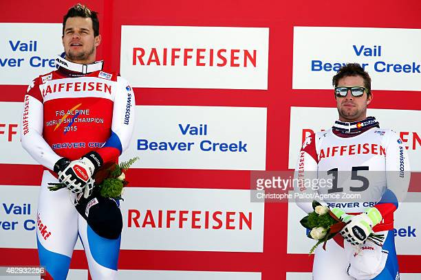 Swiss athletes Patrick Kueng and Beat Feuz are awarded 1st and 3rd place respectively during the FIS Alpine World Ski Championships Men's Downhill on...