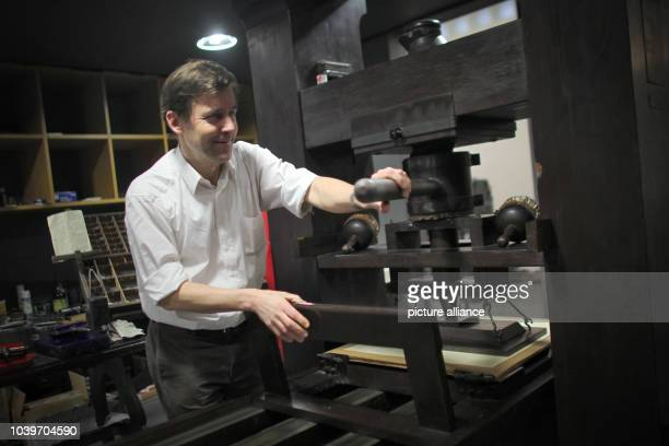 Swiss author Peter Stamm poses with a printing press at the Gutenberg Museum in Mainz Germany 22 February 2013 Stamm is awarded the 2013 Mainz Writer...