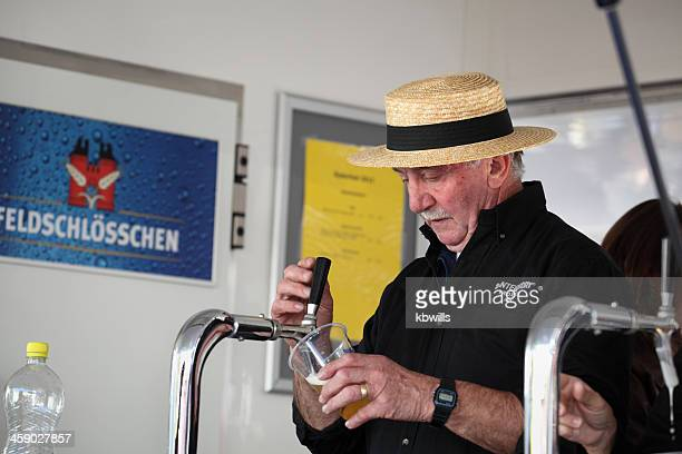 Swiss barman pours beer from spigot