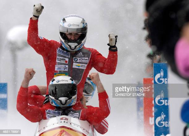 Swiss Beat Hefti Stuart Benson Bruce Tasker and Joel Fearon celebrate after the final competition race in the 4man bob World Cup competition in...