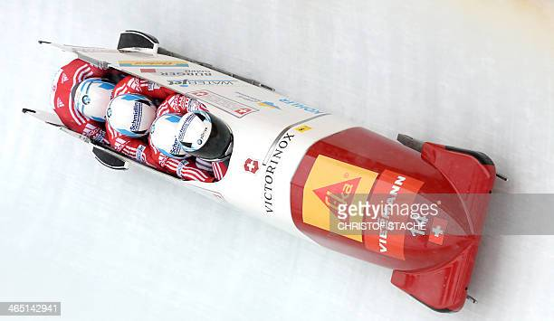 Swiss Beat Hefti Stuart Benson Bruce Tasker and Joel Fearon compete in the 4man bobsleigh World Cup first competition race in Schoenau near...