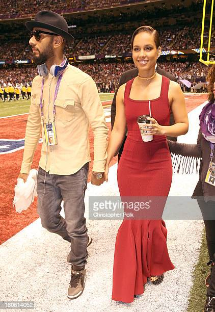 Swiss Beatz and Alicia Keys arrive to the Pepsi Super Bowl XLVII Pregame Show at MercedesBenz Superdome on February 3 2013 in New Orleans Louisiana