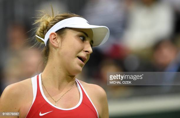 Swiss Belinda Bencic reacts during her match against Czech Barbora Strycova in the first round of the International Tennis Federation Fed Cup match...
