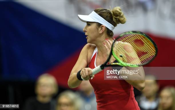 Swiss Belinda Bencic returns a ball to Czech Barbora Strycova during their match in the first round of the International Tennis Federation Fed Cup...