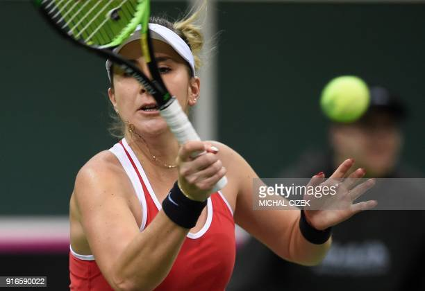 Swiss Belinda Bencic returns a ball to Czech Barbora Strycova in the first round of the International Tennis Federation Fed Cup match between Czech...