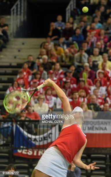 Swiss Belinda Bencic serves to Czech Petra Kvitova during the Federation Cup World Group first round tennis match between Czech Republic and...