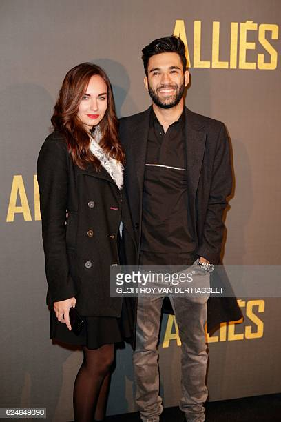 Swiss blogger Anil Brancaleoni , aka WaRTeK, and his girlfriend French actress and blogger Ophelie Duvillard pose as they arrive for the premiere of...