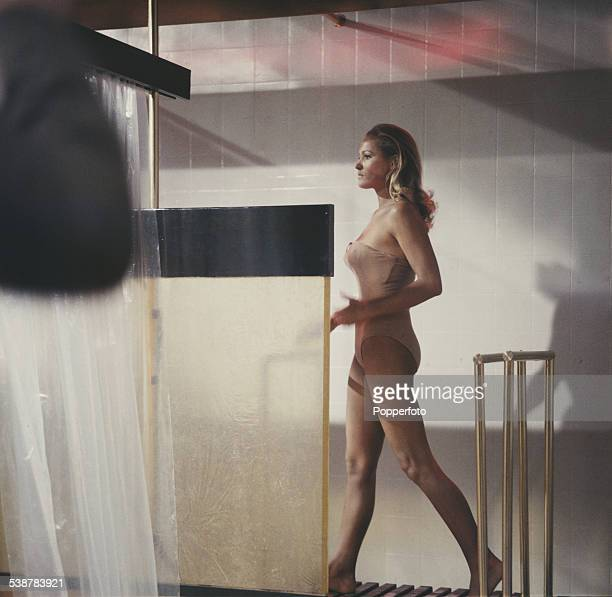 Swiss born actress Ursula Andress pictured in character as Honey Ryder wearing a flesh coloured leotard in a shower scene from the James Bond film Dr...