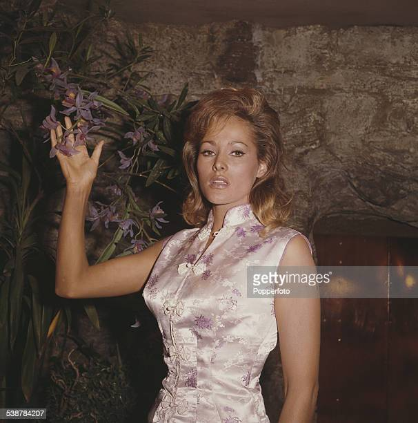 Swiss born actress Ursula Andress who plays the character of Honey Ryder in the James Bond film 'Dr No' pictured wearing a chinese style silk dress...