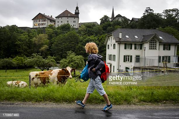 Swiss boy Leon walks on June 20 2013 to school in Moudon western Switzerland USE