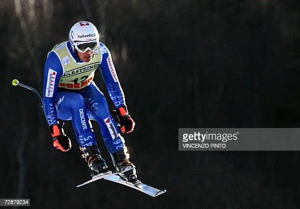 Swiss Bruno Kernen is airborned 27 December 2006 during a training in the Alpine skiing downhill world cup race in Bormio Austrian Fritz Strobl...