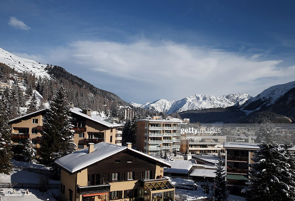 Swiss chalets and apartments are seen covered in snow in the town of Davos, Switzerland, on Saturday, Jan. 18, 2014. Next week the business elite will gather in the Swiss Alps for the 44th annual meeting of the World Economic Forum (WEF) in Davos for the five day event which runs from Jan. 22-25. Photographer: Simon Dawson/Bloomberg via Getty Images
