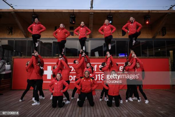 Swiss cheerleaders perform at the 'Swiss house' at the Yongpyong ski resort near the venues of the Pyeongchang Winter Olympic games in Pyeongchang on...