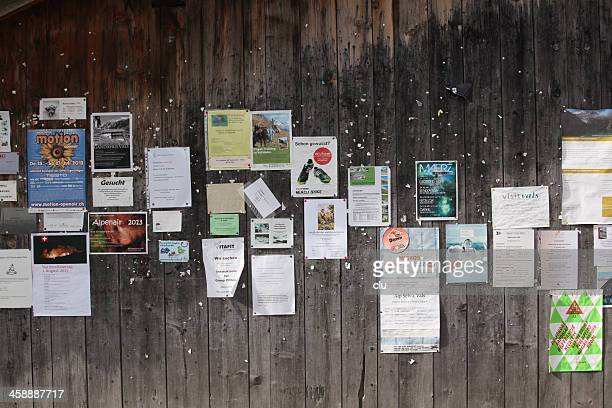 swiss community information board in public - flyer leaflet stock photos and pictures