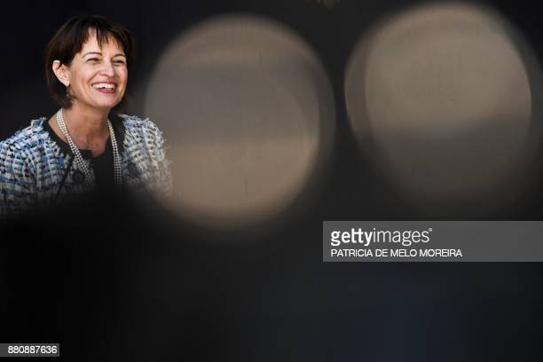 Swiss Confederation President Doris Leuthard smiles as she delivers a speech with the Portuguese president after their meeting at the Belem Palace in...