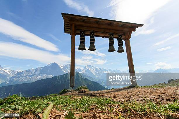 Swiss cow bells and panoramic view at Eiger, Mönch and Jungfrau