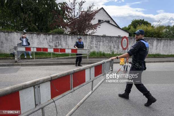 Swiss customs open a fence closing the Swiss-French border on June 14, 2020 in Thonex near Ambilly, France. - The Swiss government said on June 13,...