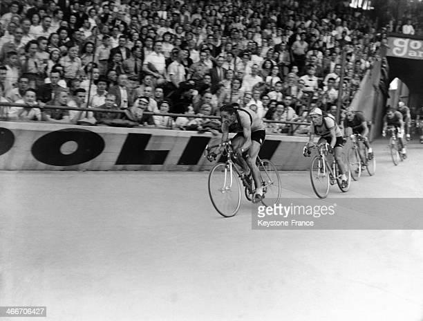 Swiss cyclist Ferdi Kubler winner of the 37th Tour de France arrives at the Parc des Princes stadium on August 7, 1950 in Paris, France.