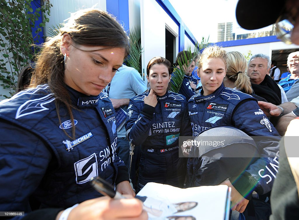 Swiss Cyndie Allemann, Natacha Gaghnang and Rahel Frey, drivers of a Ford GT, sign autographs on June 6, 2010 in Le Mans, western France. Fifty-six cars with 168 drivers will participate on June 12 and 13 in the 78th edition of the Le 24-hour endurance race.