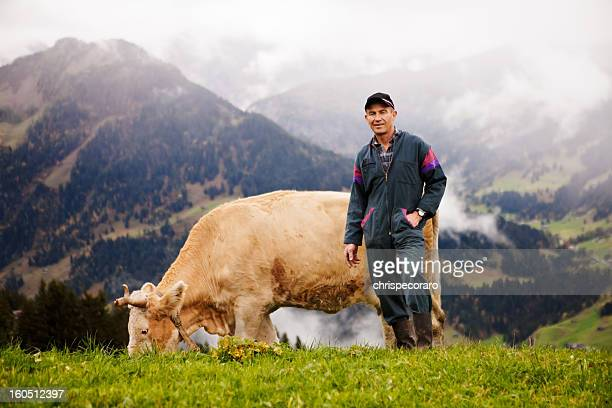 swiss dairy farmer and his prize cow - agricultural occupation stock pictures, royalty-free photos & images