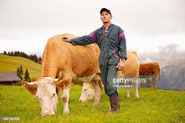 Swiss Dairy Farmer and His Prize Cows
