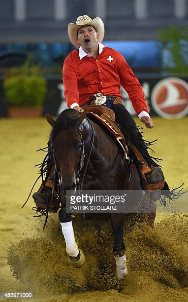 Swiss Daniel Schmutz rides on his horse Cielo Dry during the reining competition during the FEI European Equestrian Championship 2015 on August 14,...
