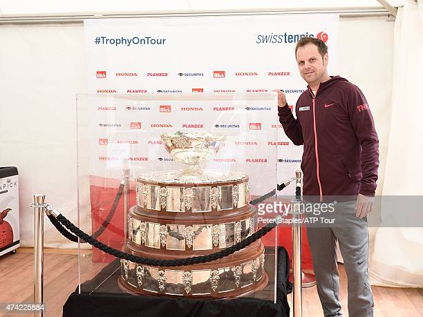 Swiss Davis Cup coach Severin Lüthi poses with the Davis Cup at the Geneva Open Parc des EauxVives on May 20 2015 in Geneva Switzerland