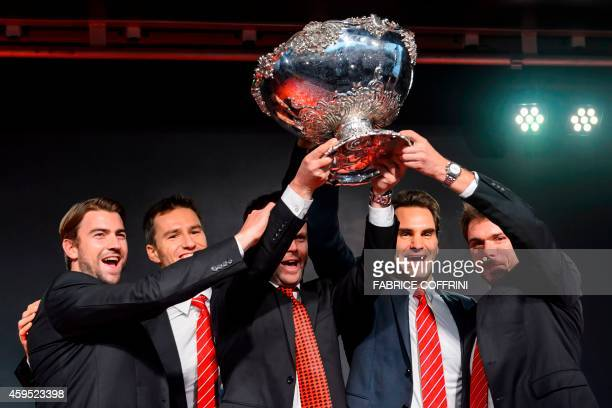Swiss Davis Cup team Michael Lammer Marco Chiudinelli team captain Severin Luethi Roger Federer and Stan Wawrinka pose with the Davis Cup tropy...