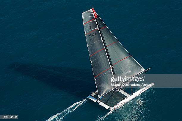 Swiss defender Alinghi huge catamaran sails at the start of the opening race of the 33rd America's Cup off Valencia's coast on February 12 2010 in...