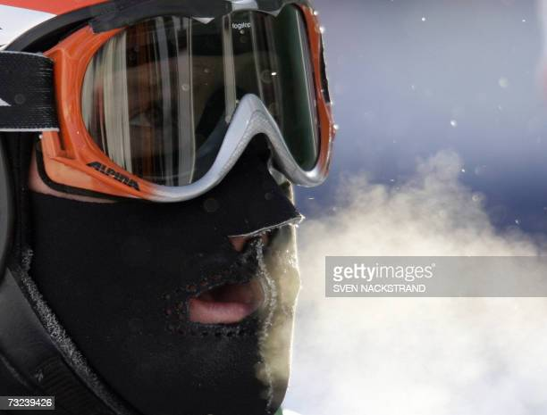 Swiss Didier Cuche wears a mask to protect his face from the cold in the finish area after the men's downhill training 07 February 2007 at the Alpine...