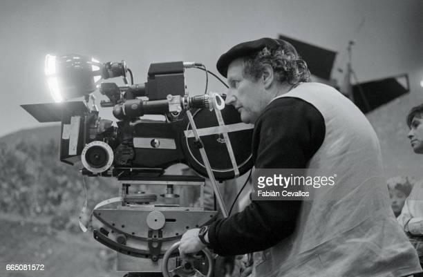 Swiss director Claude Goretta looks through the camera during the filming of his 1985 film Orfeo Filmed in Italian the film is based on the opera of...