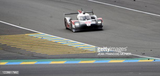 Swiss driver Sebastien Buemi competes on his Toyota TS050 Hybrid LMP1 WEC during the 88th edition of Le Mans 24 Hours endurance race, in Le Mans...