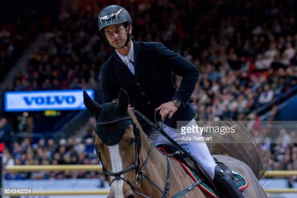 Swiss equestrian Steve Guerdat on Albfuehren's Happiness rides in the Accumulator Show Jumping Competition during the Gothenburg Horse Show in...