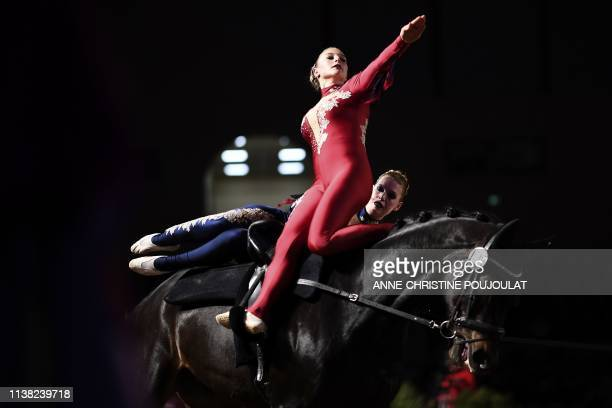 Swiss equestrians vaulters Zoe Maruccio and Syria Schmid perform during the FEI Vaulting World Cup final competition on April 18, 2019 in the Ecole...