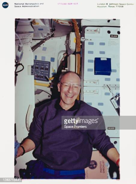 Swiss ESA astronaut Claude Nicollier sitting in the middeck area of the Space Shuttle Discovery ahead of his spacewalk during shuttle mission...