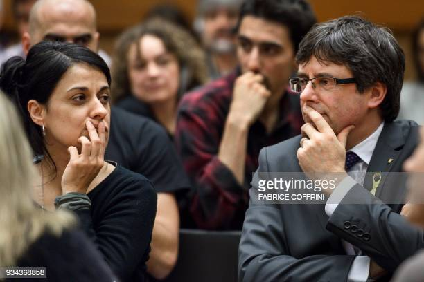 Swiss exiled proindependence former member of the Catalan parliament Anna Gabriel speaks with proindependence Catalonia's deposed leader Carles...