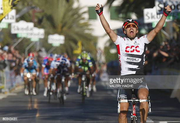 Swiss Fabian Cancellara celebrates on March 22 2008 as he crosses the finish line of the 99th MilanSan Remo classic cycling race Fabian Cancellara...