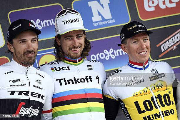 Swiss Fabian Cancellara of TrekSegafredo Slovakian world champion Peter Sagan of Tinkoff and Belgian Sep Vanmarcke of Team LottoNLJumbo celebrate on...