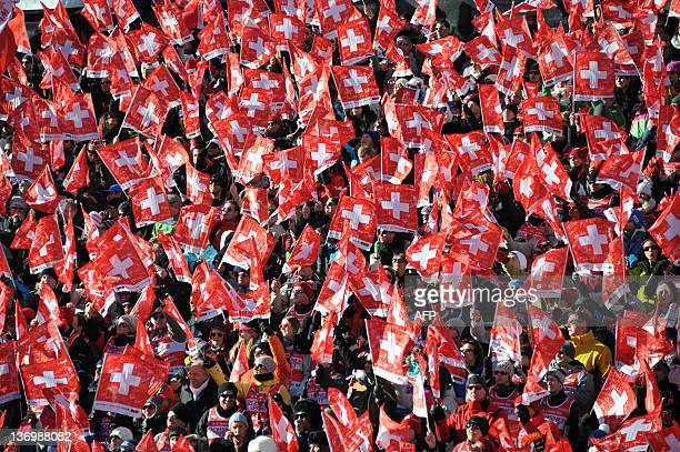 Swiss fact react after the victory of Beat Feuz of Switzerland in the Men's downhill race at the FIS Alpine Skiing World Cup on January 14 2012 in...