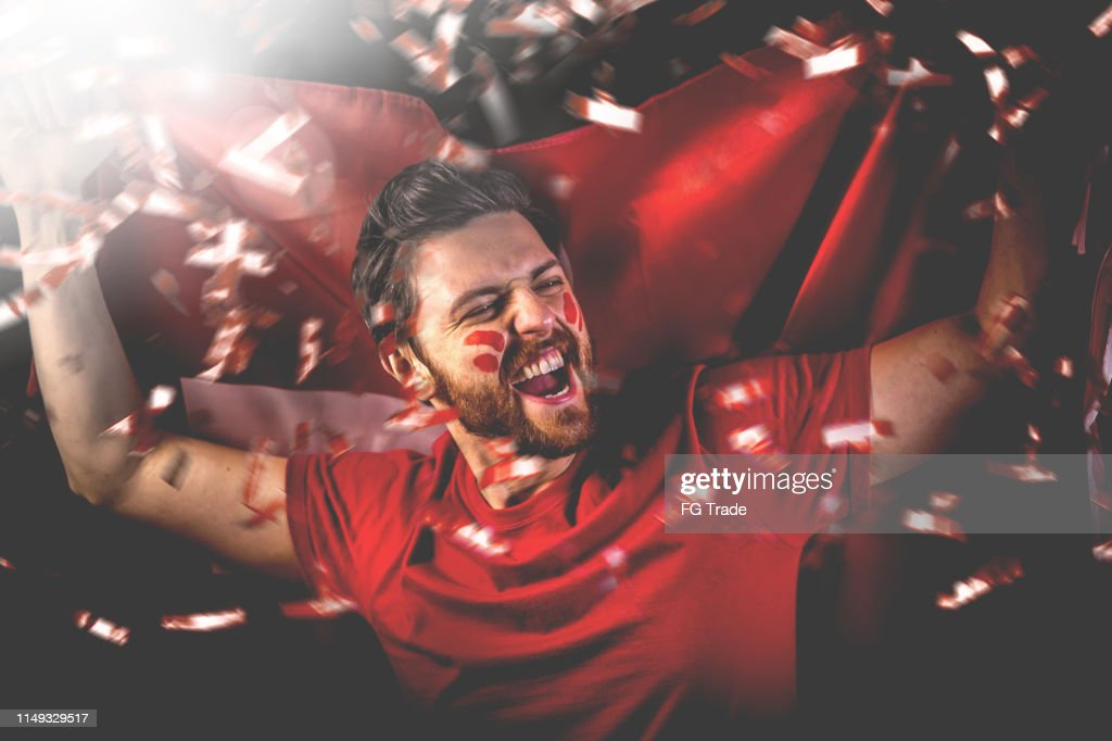 Swiss fan celebrating with the national flag : Stock Photo